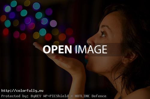 Girl blowing sparkles – Creative photo
