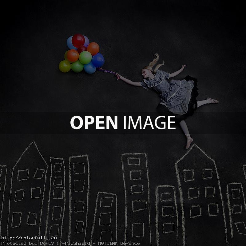 Girl flying with balloons – Creative photo
