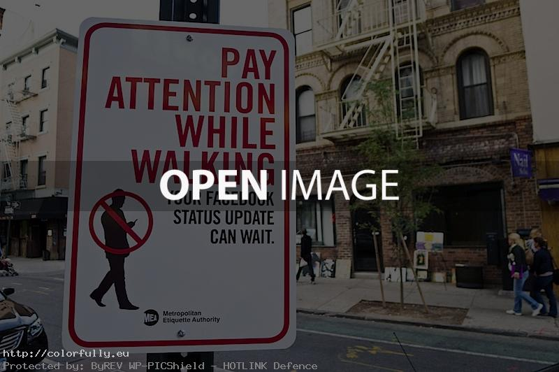 Pay attention while walking. Your Facebook status update can wait – Sign